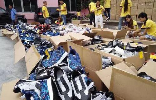 9000多双热销鞋在东莞秦粤丰鞋业有限公司场内当场被当众销毁